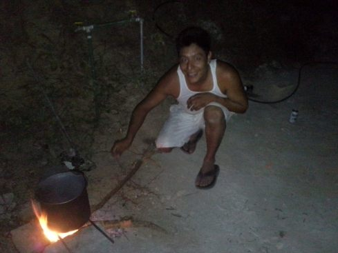 Uriel stoking the fire so our black beans cook. Our albanil, our sobrino, our friend.