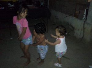 Wild children of Oaxaca: Lucia and her cousins having unstructured playtime!  Yes, they are riding a horse (broom) together