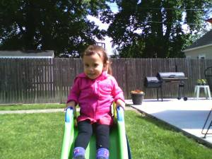 Lucia in a hoody! Enjoying her own private slide in Paw-Paw and Gamma's yard.