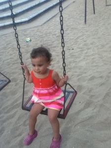 Lucia's big enough to hold on to the swings now; good because that's the only option here!