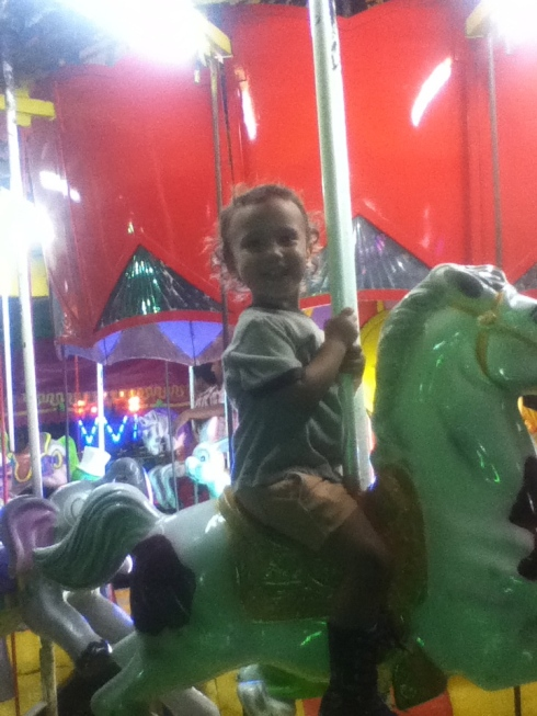 Lucia on the merry go round, celebrating one of her countries' independence
