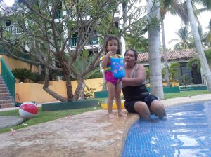 Lucia swimming with her Abia Paulina at one of the many pools we visited